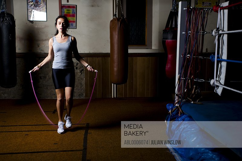 Woman skipping in a boxing gym