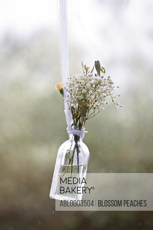 Hanging Bottle with Wildflowers at Wedding Ceremony
