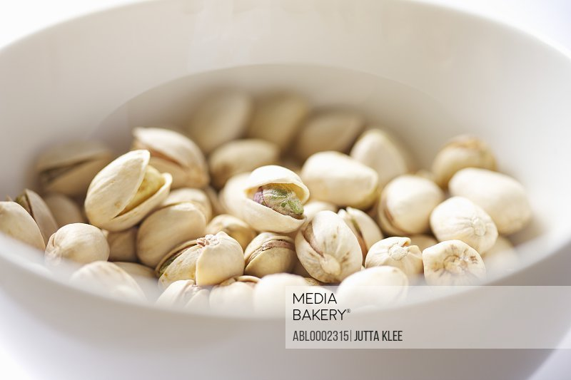 White Bowl Filled with Pistachios