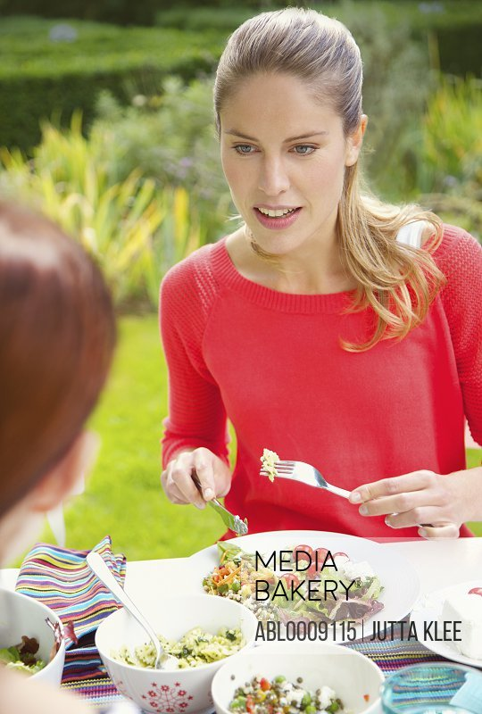 Woman Having Lunch in Garden with Friend