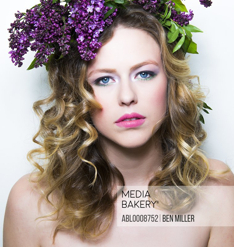 Young Woman with Purple Flowers on Head