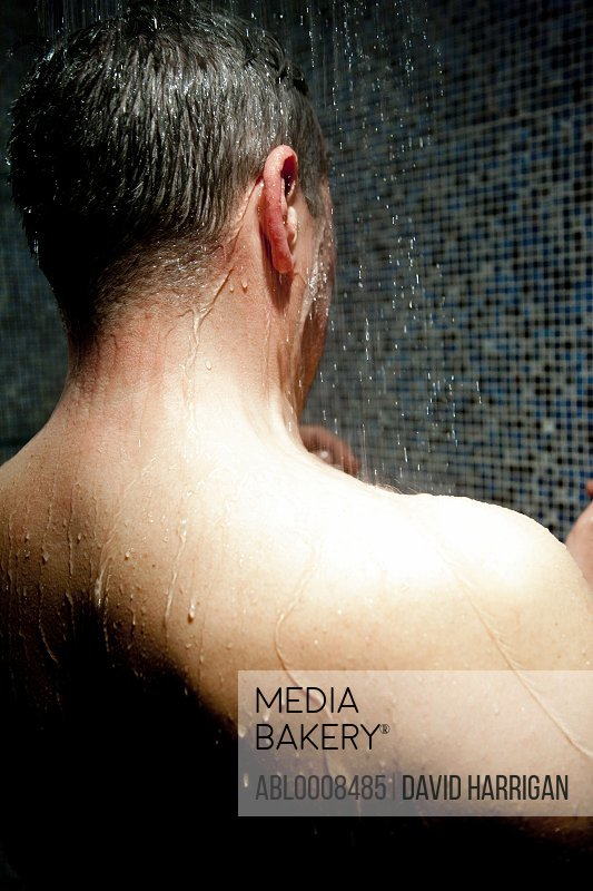 Back View of Man Taking Shower