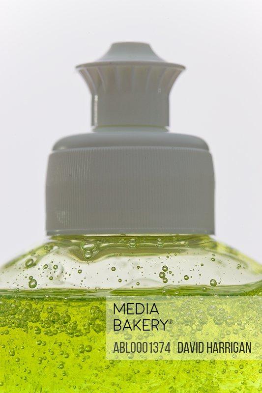 Close up of a bottle of dishwashing detergent