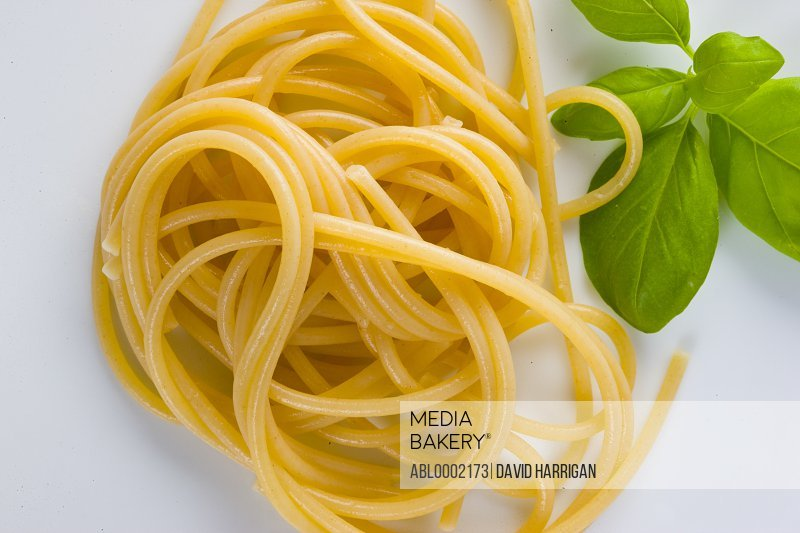 Spaghetti and Basil Leaves