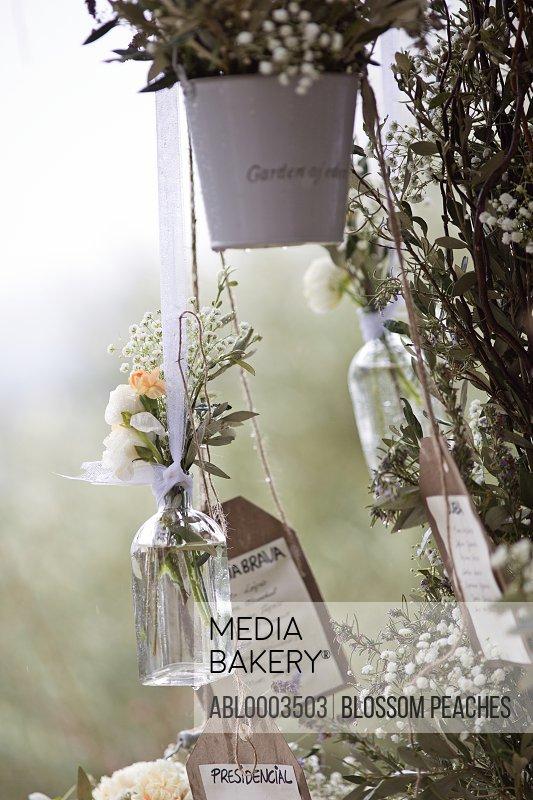 Hanging Flower Arrangements at Wedding Ceremony