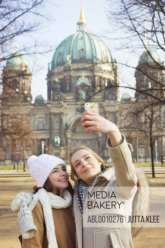 Teenage Girls Taking Selfie in front of Berlin Cathedral
