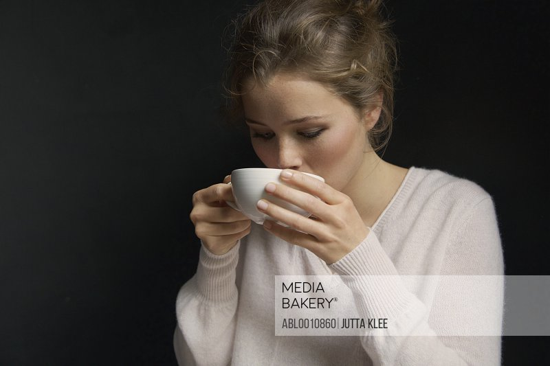 Young Woman Sipping Hot Drink