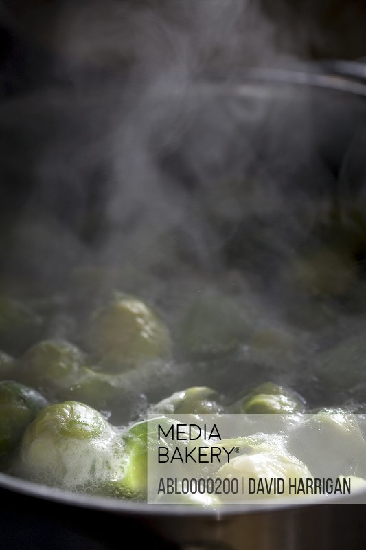 Brussels sprouts cooking in a pan of boiling water
