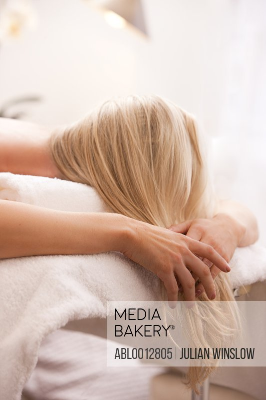 Close up of a woman lying face down on a massage table