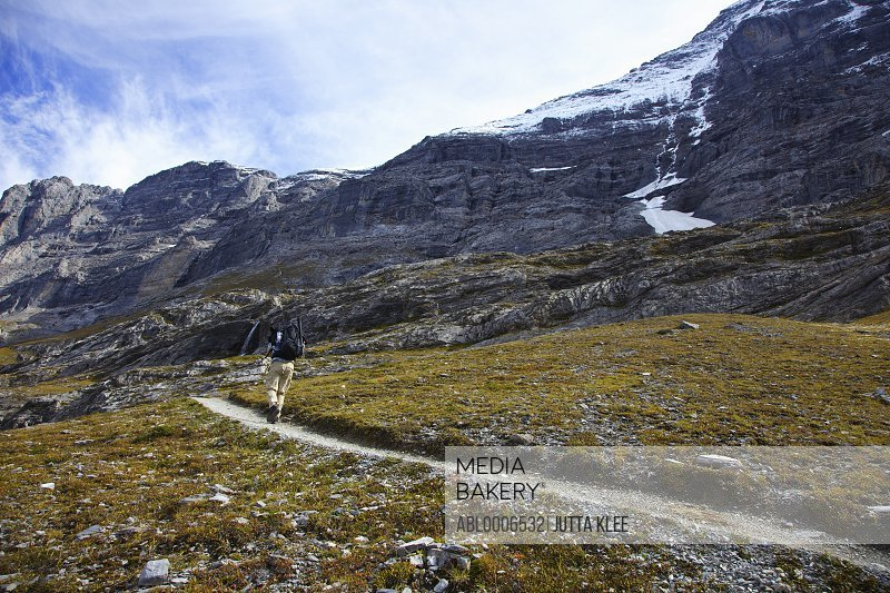 Back View of Hiker Climbing Eiger Trail