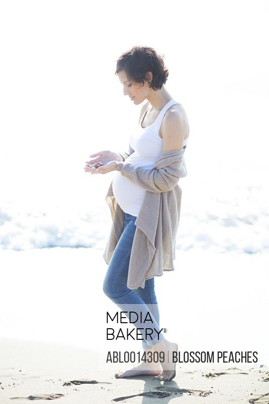 Pregnant Woman Walking on Beach