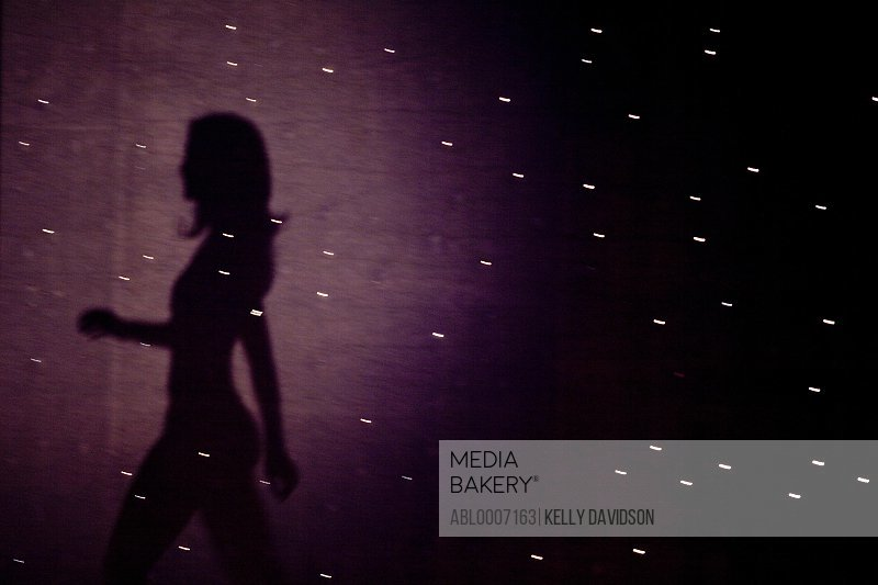 Woman's Shadow Projected on Starry Backdrop