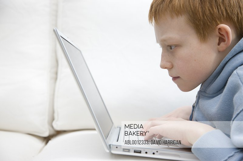 Boy using a laptop computer