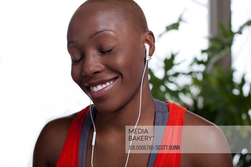 Young Woman Wearing Earphones