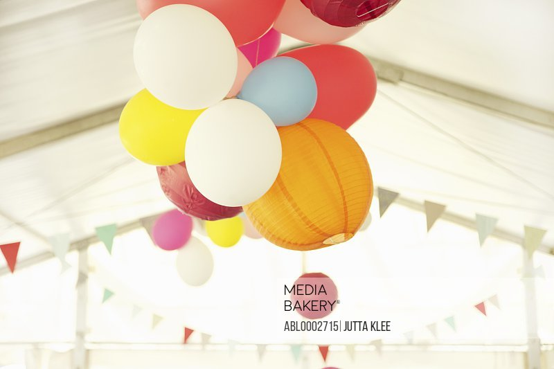 Paper Lanterns and Party Balloons Floating Inside a Marquee