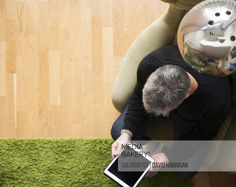 Man Using Digital Tablet, Elevated View