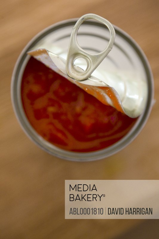 Elevated view of an open tin of tomatoes