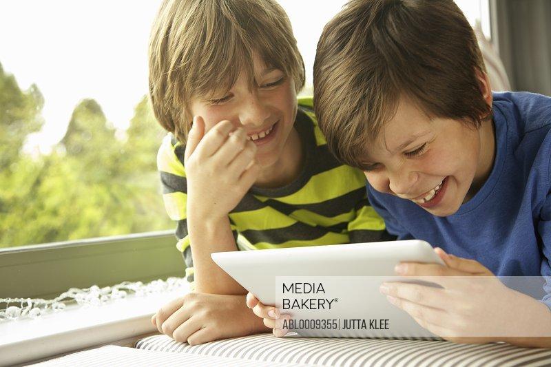 Boys Using Digital Tablet Smiling