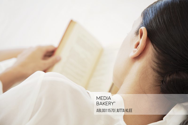 Back view of woman reading book