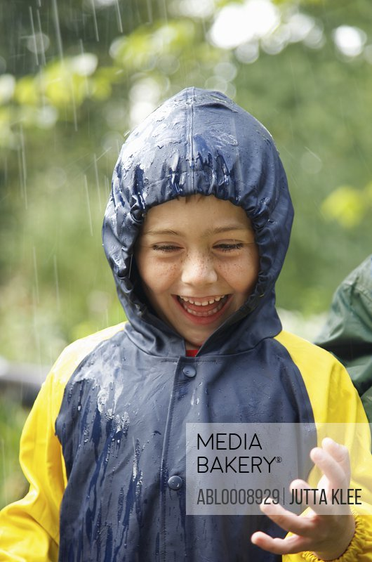 Smiling Young Boy in the Rain