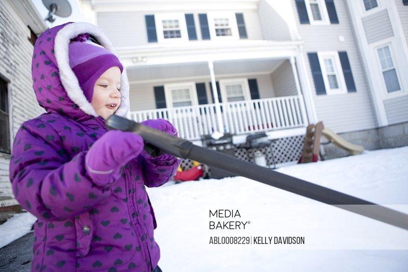 Girl Shoveling Outdoors