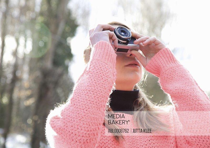 Teenage Girl Taking a Photograph