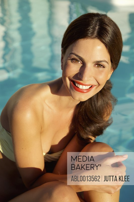 Smiling Woman by Swimming Pool