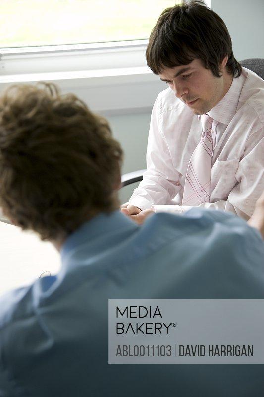 Portrait of young businessmen talking