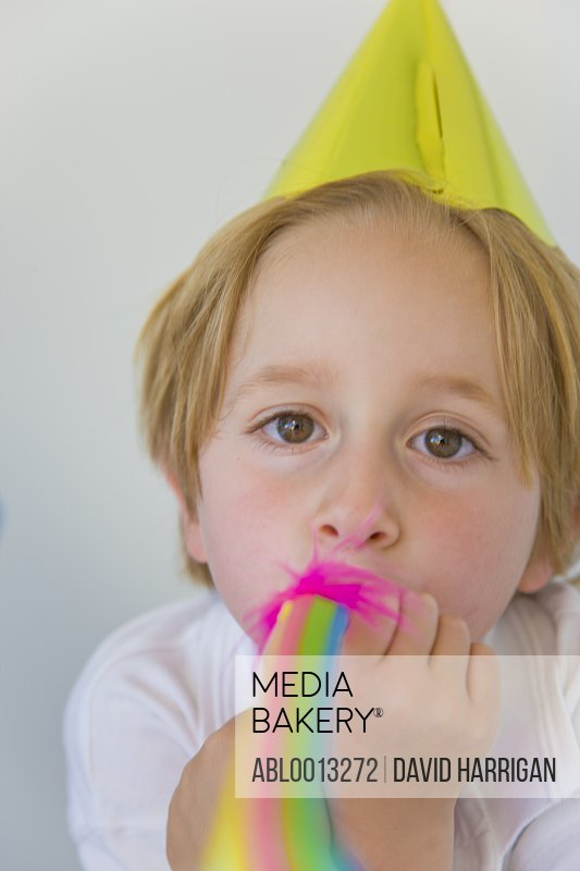 Boy Blowing Party Blower