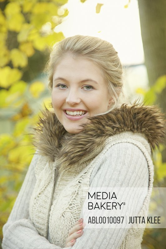 Portrait of Young Woman Outdoors Smiling