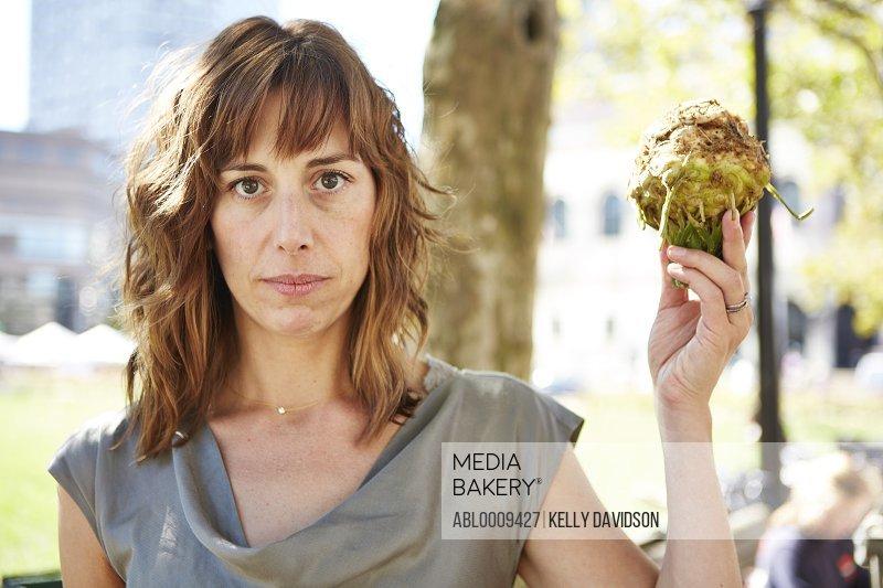 Woman Holding Celeriac