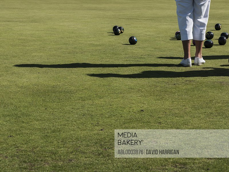 Woman Playing Flat Lawn Bowls, Low section