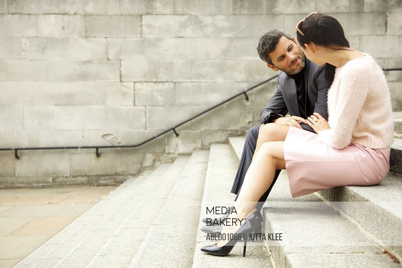 Couple Sitting on Steps Outdoors