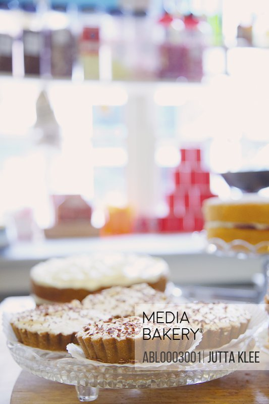 Shop Interior with Tarts on Glass Cake Stand