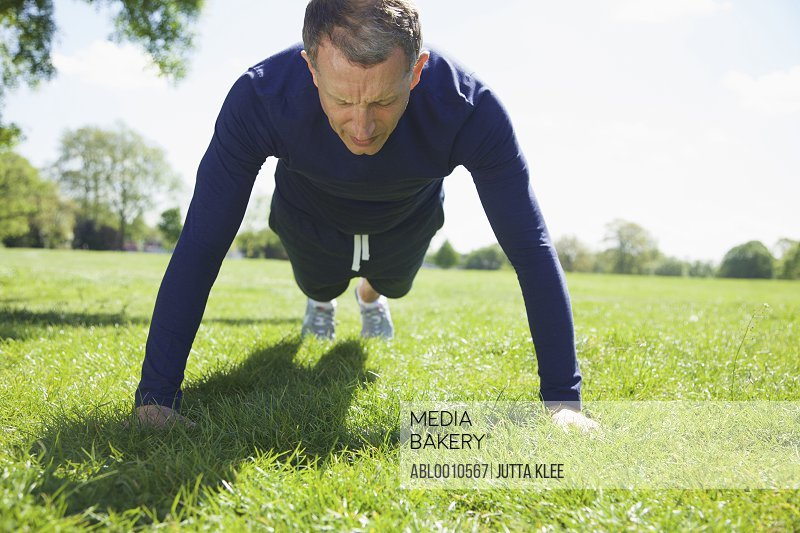 Mature Man doing Pushups in the Park