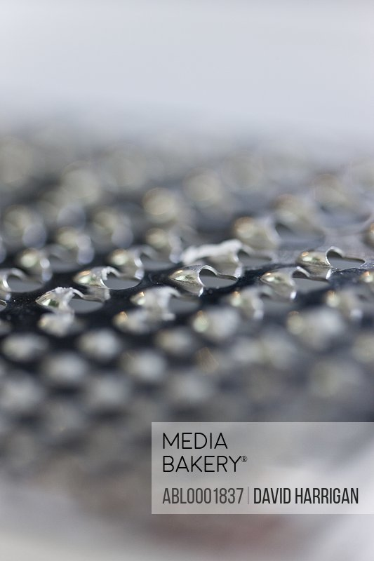 Extreme close up of a cheese grater