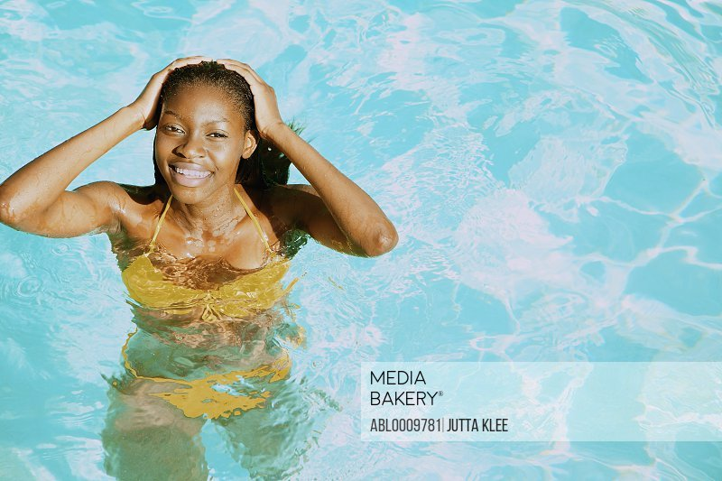 Young Woman in Swimming Pool Smiling