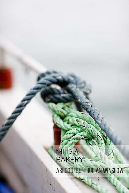 Close up of knotted ropes in a fishing boat