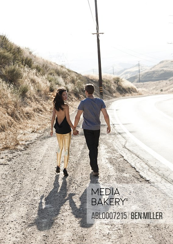 Couple Walking Down Deserted Road