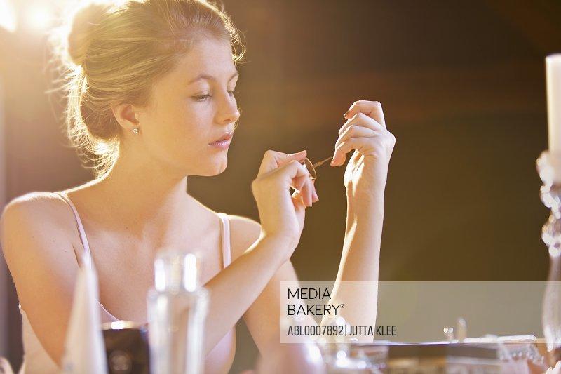 Young Woman Applying Nail Polish