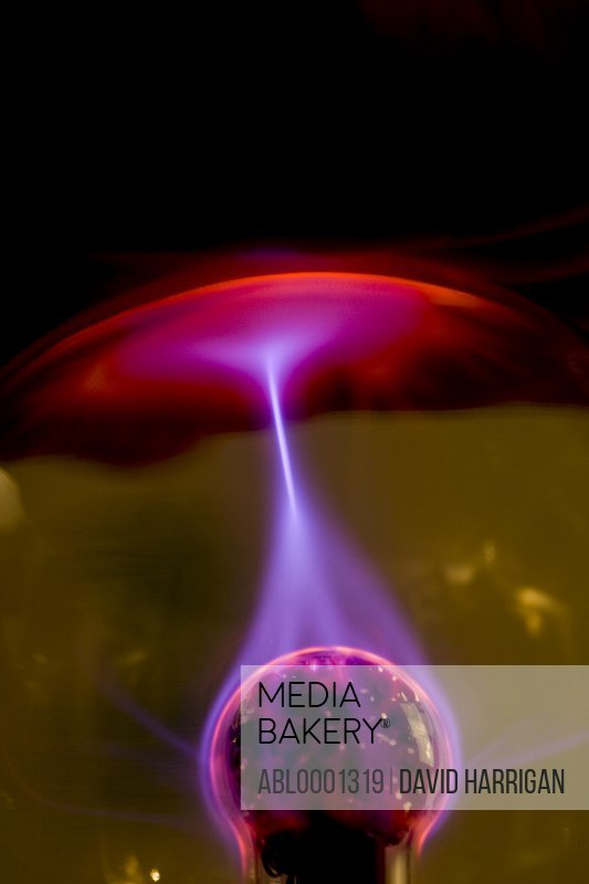 Plasma ball with red purple and pink electrical discharge