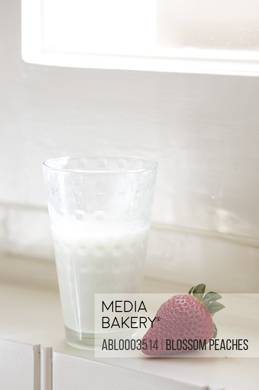 Glass of Milk and Strawberry