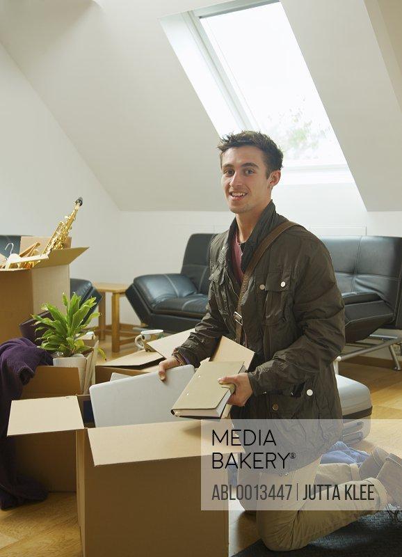 Man Unpacking Cardboard Box