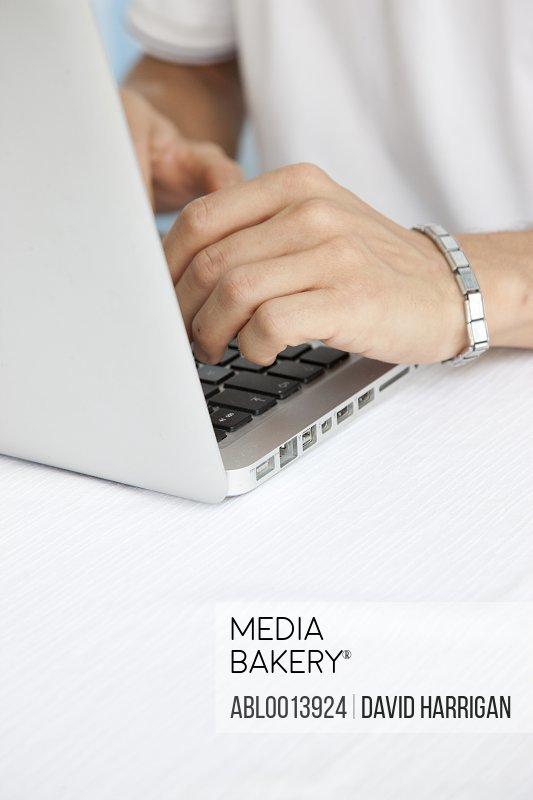 Close up of Man's Hands Using Laptop
