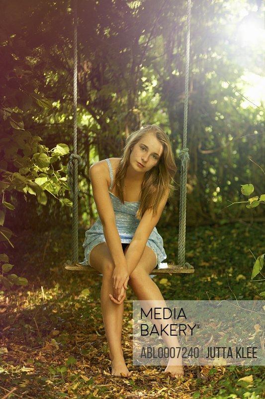 Teenage Girl on Swing