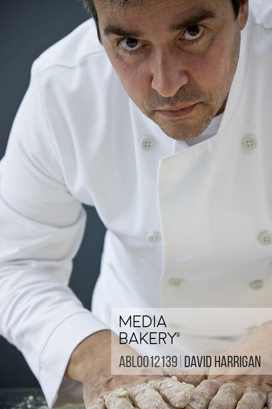 Chef kneading pasta dough