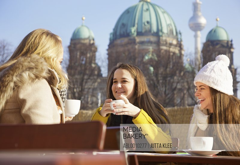 Teenage Girls at Outside Cafe by Berlin Cathedral