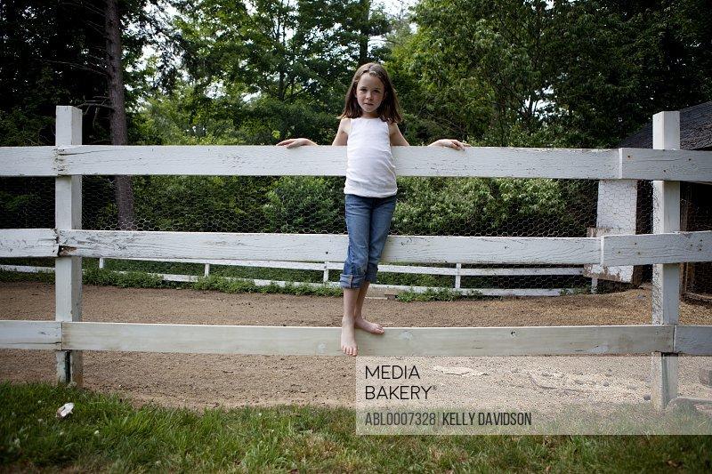 Girl Standing on Wood Fence
