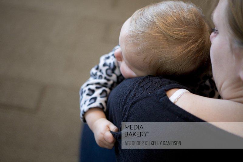 Baby Girl Resting on Mother's Shoulder