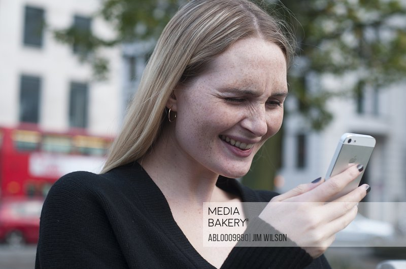 Woman Using Smartphone Squinting